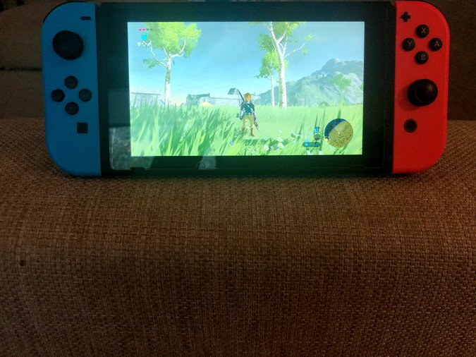NINTENDO SWITCH AND 128 GB MEMORY CARD